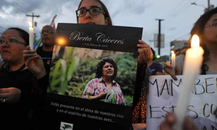 A woman holds a portrait of Berta Cáceres Flores in Tegucigalpa in March.