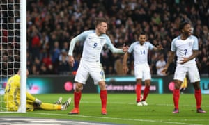 Vardy celebrates with teammates Theo Walcott and Raheem Sterling.
