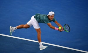 Lucas Pouille plays a backhand return.