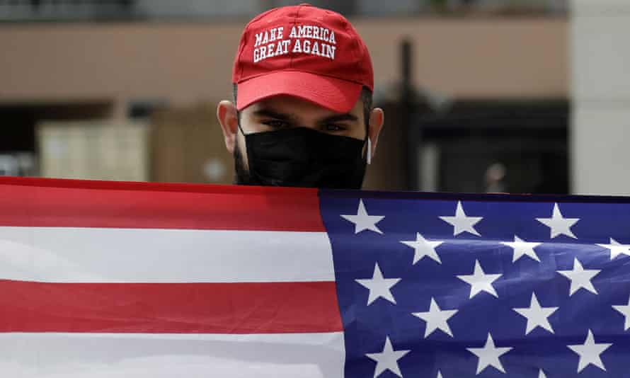A supporter of President Trump waves a flag in Los Angeles.