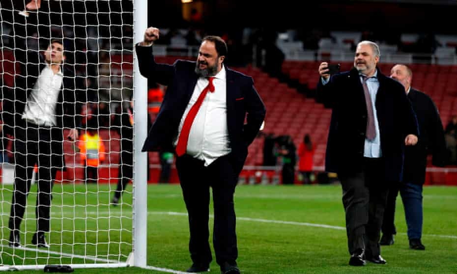 Olympiakos owner Evangelos Marinakis takes to the Emirates pitch after the Europa League win over Arsenal. He met several players after the game.