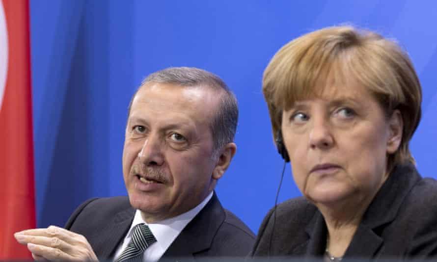 German chancellor Angela Merkel listens to Turkey's president Recep Tayyip Erdoğan at a press conference in Berlin last month.