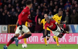 Manchester United's Paul Pogba is fouled by Wolverhampton Wanderers' Willy Boly.