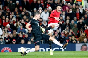 Manchester United's Mason Greenwood (right) scores his sides fourth goal.