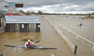 Members of Worcester Canoe Club kayaking on a flooded Worcester racecourse.