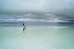 Haixi, China: A woman stands in Chaka Salt Lake