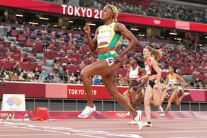 Elaine Thompson-Herah of Jamaica crosses the line to win with Great Britain's Dina Asher-Smith (centre) beaten by Ajla Del Ponte of Switzerland for second place.