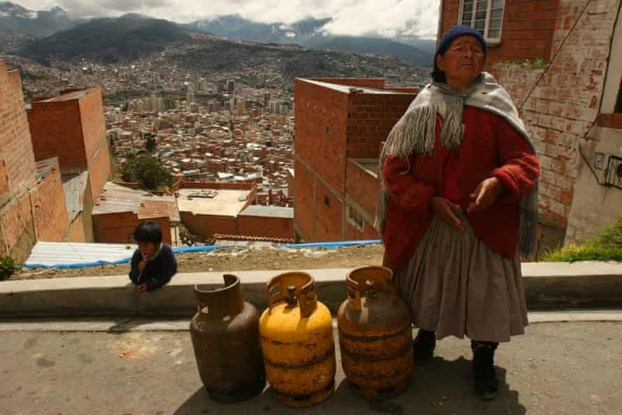 Owner of a small restaurant in the outskirts of La Paz waits to buy cooking gas in a street of the Bolivian capital.