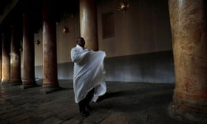 A worshipper prays in the Church of the Nativity in Bethlehem, in the Israeli-occupied West Bank, January 6, 2020.
