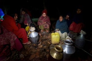 Sita Giri and other women from Barkobot village in Nepal's Sindhupalchowk district wait to fill water pots. The village's main water source dried up after the earthquake that struck Nepal last April.
