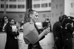 Billie Piper arriving. She was nominated for best actress and best drama series for I Hate Suzie