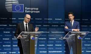 EU Commissioner of Economic an d Financial Affairs, Taxation and Customs Pierre Moscovici (L) and Dutch Finance Minister and president of Eurogroup Jeroen Dijsselbloem give a joint press conference after an Eurogroup Council meeting on May 11, 2015 at EU Headquarters in Brussels. AFP PHOTO/JOHN THYSJOHN THYS/AFP/Getty Images