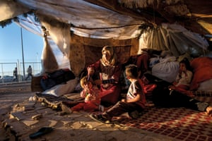 Iman Zenglo, 30, with her five children in a tent outside the Kilis camp in Turkey.