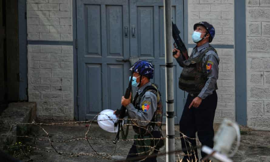 Photo taken and received from an anonymous source via Facebook on 25 March 2021 shows security forces holding their weapons on a street in Taunggyi in Myanmar's Shan state, during a crackdown on protests against the military coup.