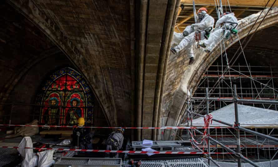Workers plaster stonework at the reconstruction site of Notre Dame, which was damaged in a fire two years ago.