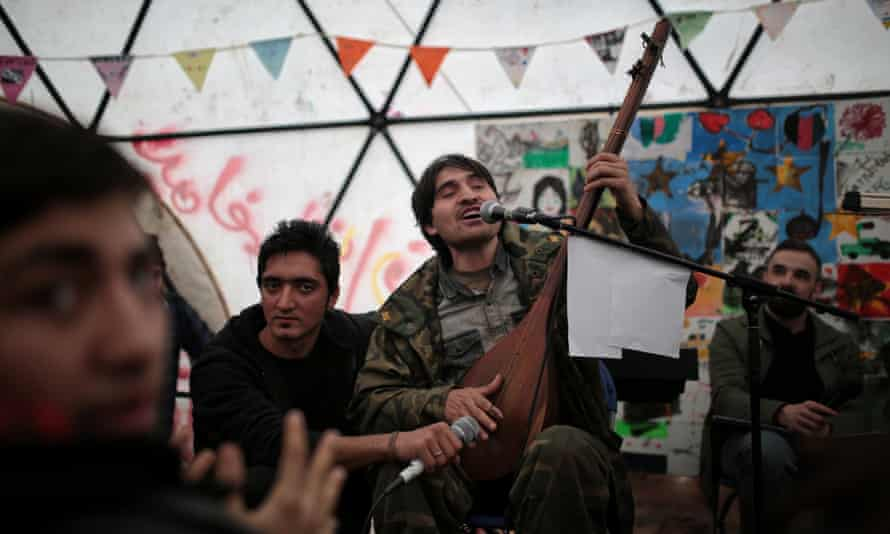 Afghan refugees perform at the Letters Live show in Calais's Jungle camp.