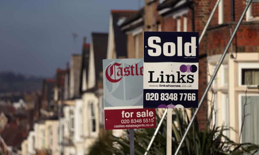 Estate agents' signs outside houses in London