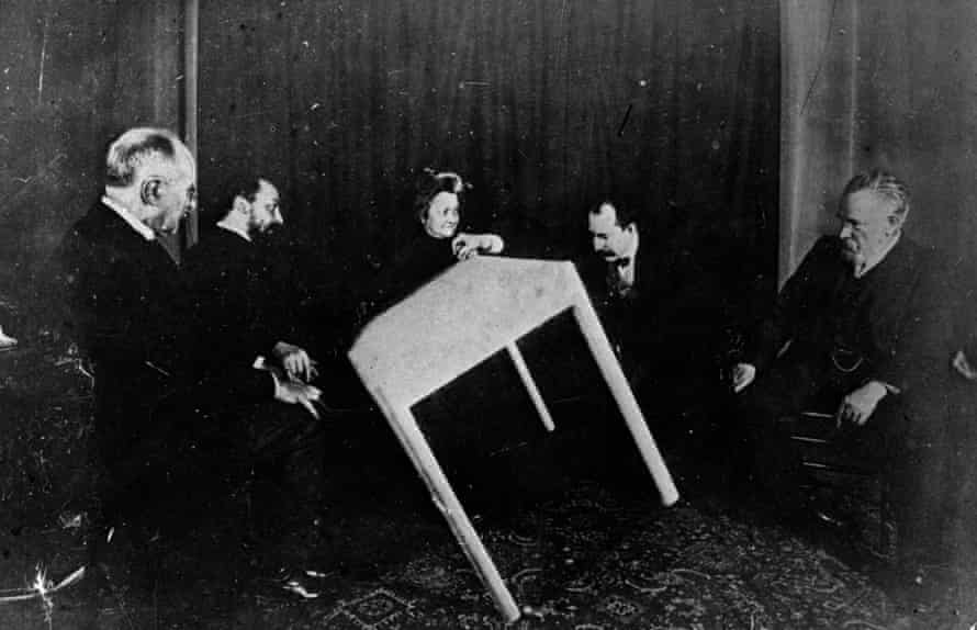 A table apparently moves of its own accord during a seance in Paris, c1900.