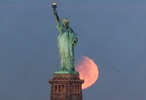 In frame behind the Statue of Liberty, New York, US
