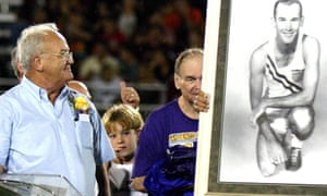 Bobby Joe Morrow (left) is handed an Olympic portrait of himself during the 2006 inauguration of the stadium that bears his name in San Benito, Texas.