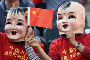 China supporters don some scary mask for the game against New Zealand