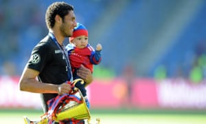 Mohamed Elneny celebrates with trophy and son after Basel won the Swiss Super League in 2014