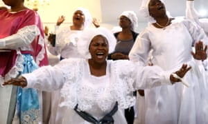 Worshippers sing as they offer thanksgivings during Sunday service at the New Jerusalem Parish