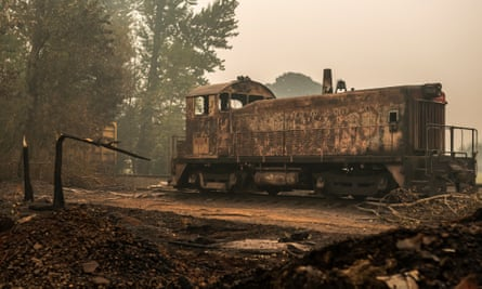 A burned-out wagon is found abandoned Thursday at a lumber yard in Sandy, Oregon.