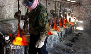 Ren Limin, a worker at the Jinyuan Company's smelting workshop, prepares to pour rare earth metal Lanthanum into a mould near the town of Damao in China's Inner Mongolia Autonomous Region.