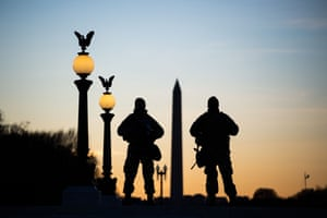 National Guard soldiers keep guard in front of the Capitol Building and near the Washington Monument