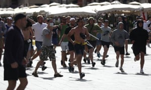 Russian fans run at England fans as they clash ahead of the game against Russia on June 11, 2016 in Marseille, France.