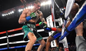 Bernard Hopkins is knocked out of the ring by Joe Smith Jr. Hopkins finishes his long career with a 56-8-2 record