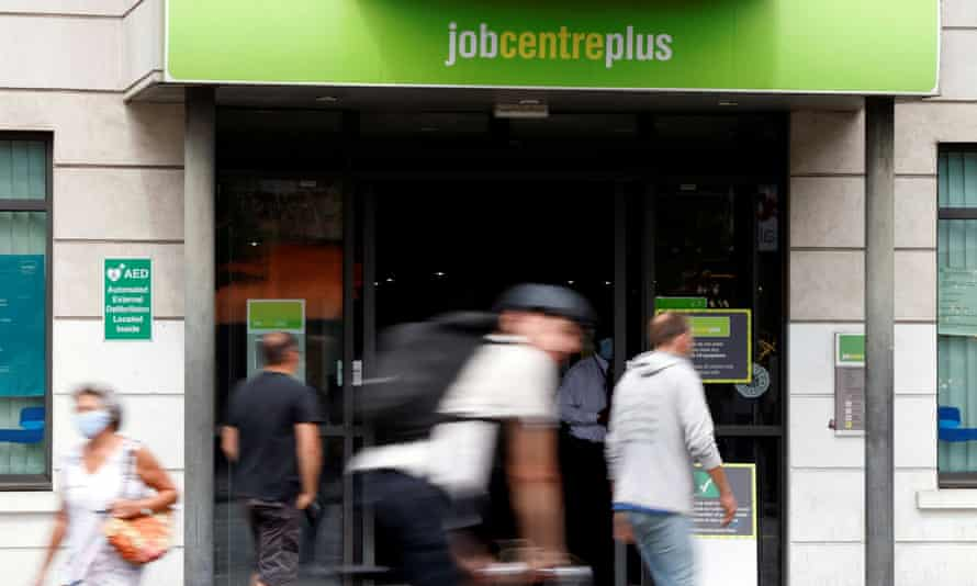 People walk past a branch of Jobcentre Plus