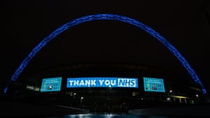 The arch at Wembley Stadium was lit up in blue and a thank you message put up outside England's home ground