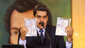 President Nicolas Maduro shows what Venezuelan authorities claim are identification documents of former US special forces and US citizens Airan Berry and Luke Denman