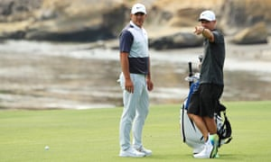 Brooks Koepka with his caddie, Ricky Elliot, during a practice round at Pebble Beach before the US Open.