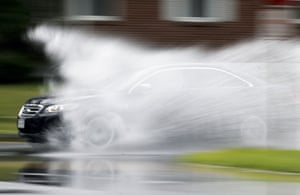 <strong>Albany, New York, US</strong> A vehicle drives through a puddle after heavy rainfall. Scattered rain and thunderstorms are expected in the region through Wednesday