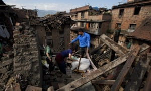 A Nepalese family collects belongings from their home in Bhaktapur on the outskirts of Kathmandu