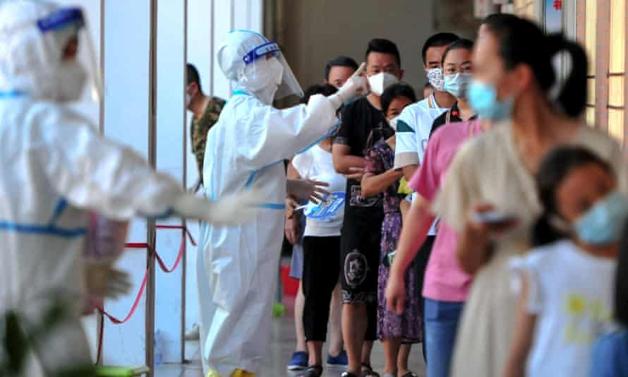 Residents queue for coronavirus tests amid a new outbreak in China'sFujian province.