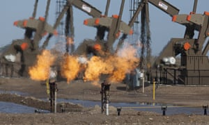 Natural gas is flared off as oil is pumped in the Bakken shale formation in North Dakota, US.