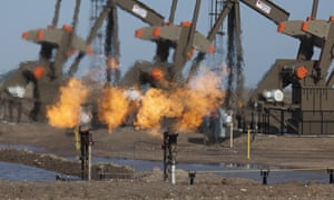 Natural gas is flared off as oil is pumped in the Bakken shale formation, Watford City, North Dakota, United States