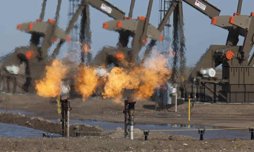Natural gas is flared off as oil is pumped in the Bakken shale formation, North Dakota, US