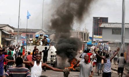 Anti-Kabila demonstrators and UN peacekeepers last week.