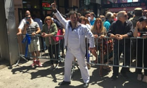 'Brian Travolta', aka Brian Bergdoll, a John Travolta impersonator, poses at the event outside Lenny's Pizzeria on 12 June.