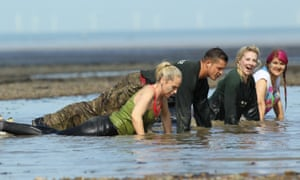 Women doing press up on the beach at GI Jane Bootcamp