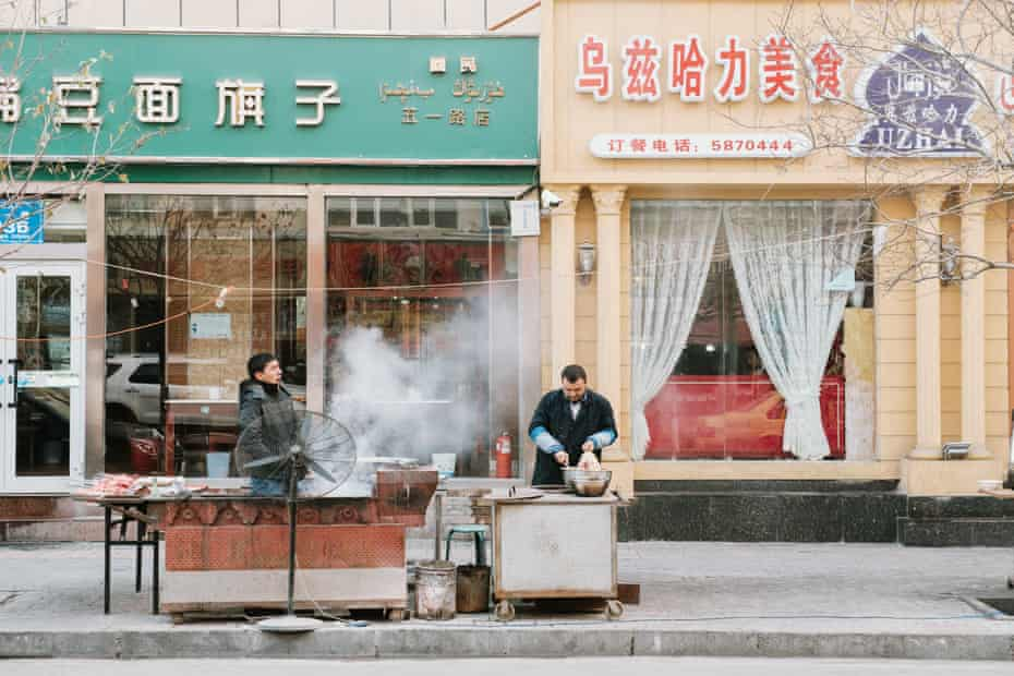 Restaurant owners grilling fresh mutton kebabs in China