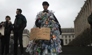 A man wears a costume of empty plastic bottles during a climate protest in Brussels, Friday, March 15, 2019. From the South Pacific to the edge of the Arctic Circle, students mobilized by word of mouth and social media skipped class Friday to protest what they believe are their governments' failure to take though action against global warming.