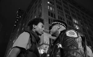 Contemporary issues, third prize, singles - John J Kim March against police violence: Lamon Reccord stares down a police sergeant during a protest following the fatal shooting of Laquan McDonald by police in Chicago, Illinois, US