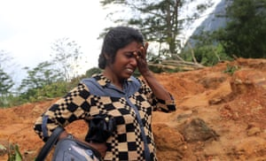Mudslide survivor Shirani Mallika grieves over the loss of her relatives in a landslide
