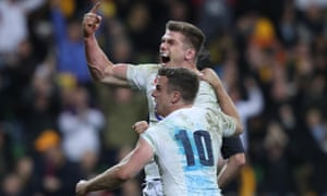 Owen Farrell celebrates with George Ford after scoring a late try.